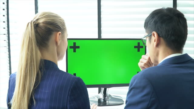 two business person talking with laptop green screen - computer monitor mockup stock videos & royalty-free footage