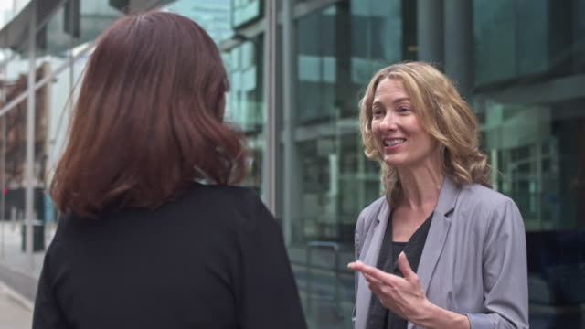 two business women talking in the streets of london, uk - partnership stock videos & royalty-free footage