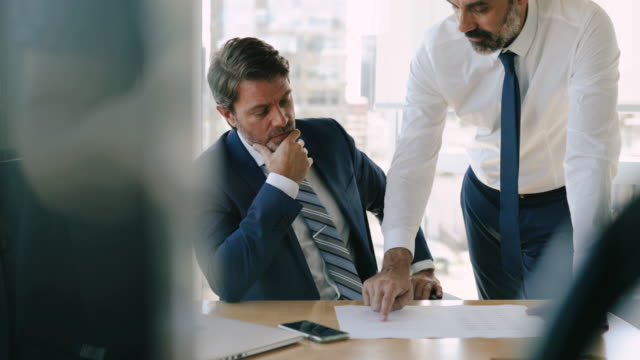 two businessman discussing at office meeting - business conference stock videos & royalty-free footage