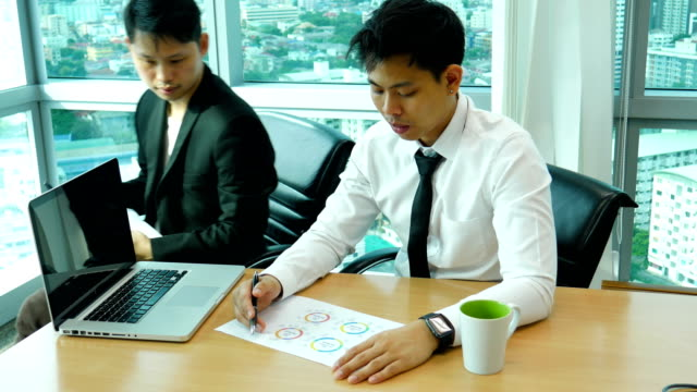 Two Businessman Discussing in Meeting Room