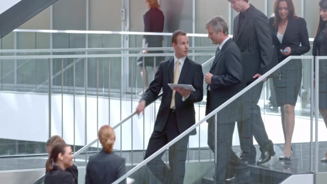 ds two businessman talking over tablet on the stairs - corporate business stock videos & royalty-free footage