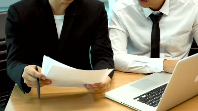 two businessman working in the office - report document stock videos & royalty-free footage