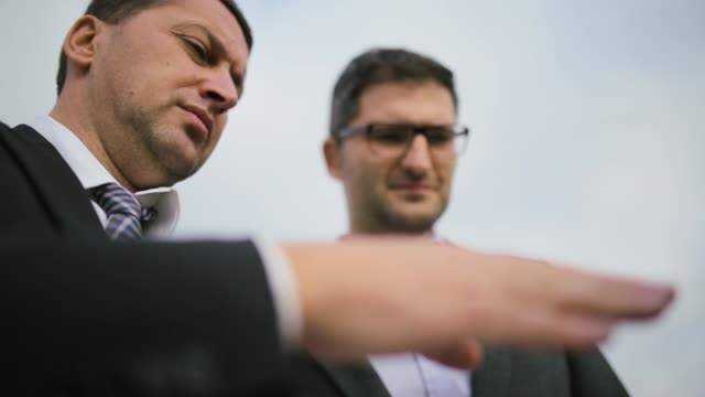 Two businessmen discussing about work, low angle view close up