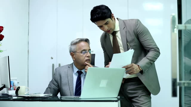 Two businessmen doing meeting in the office, Delhi, India