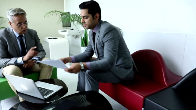 stockvideo's en b-roll-footage met two businessmen doing meeting in the office, delhi, india - indisch subcontinent etniciteit