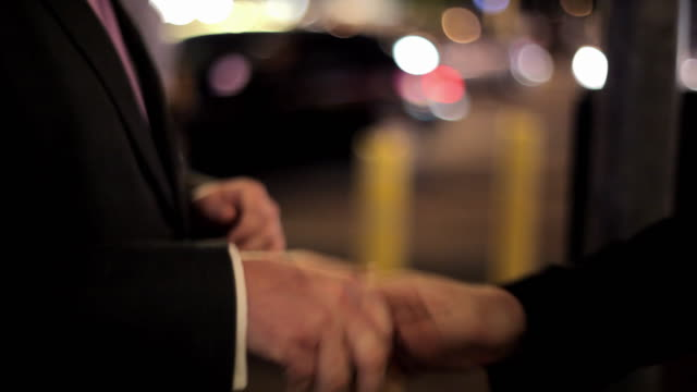 Two businessmen give each other cool handshakes on The Strip in Las Vegas.