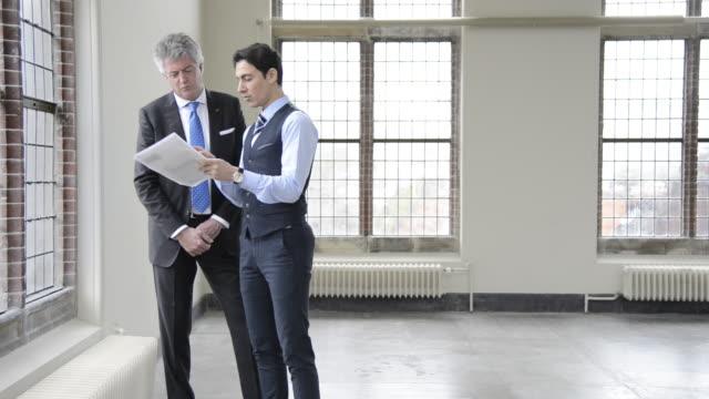 two businessmen having informal meeting - full length stock videos & royalty-free footage