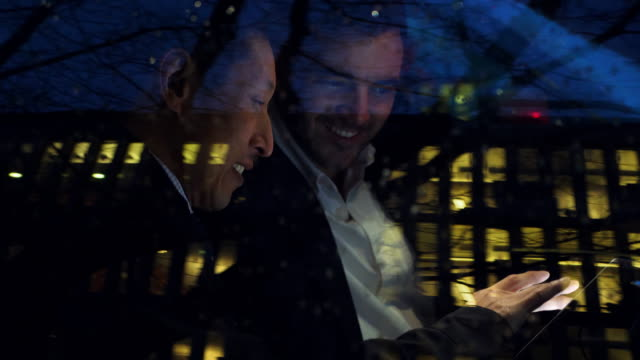 ms two businessmen having meeting in car after work - deadline stock videos & royalty-free footage