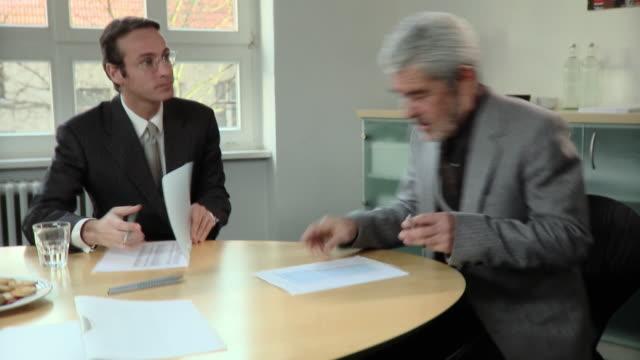 MS, TU, TD, Two businessmen having meeting in conference room, Berlin, Germany