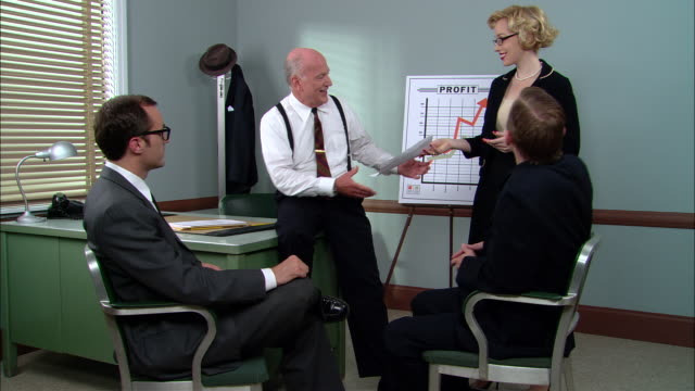 vídeos de stock, filmes e b-roll de ms two businessmen in meeting with boss/ woman bringing in paper to give to boss/ boss looking at her lecherously and making comment to men as she leaves/ new york city - secretária