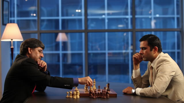 two businessmen playing chess  - chess stock videos & royalty-free footage