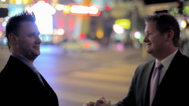Two businessmen shake hands on The Strip in Las Vegas.