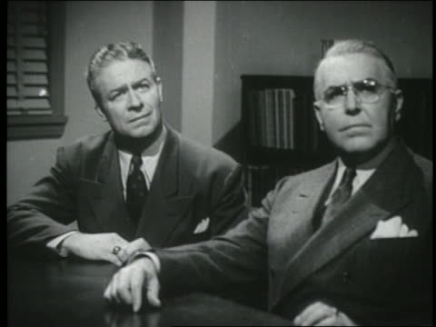 b/w 1944 two businessmen sitting at table listen intently - formal businesswear stock videos & royalty-free footage