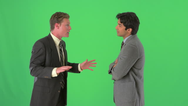 two businessmen standing and talking on greenscreen