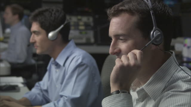cu two businessmen talking on headsets in television studio control room / culver city, california, usa - headset stock videos & royalty-free footage