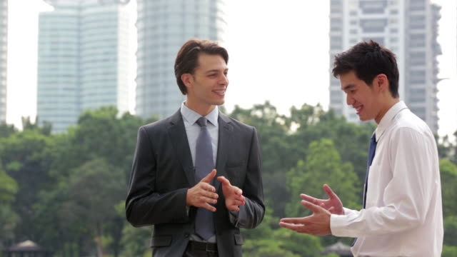 MS Two businessmen talking together outdoors.