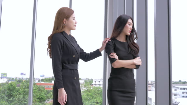 two businesswoman consoling teamwork strategy in office - comforting colleague stock videos & royalty-free footage
