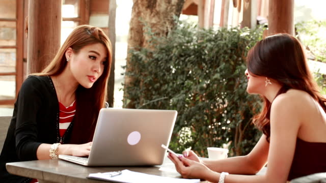 Two businesswoman meeting and talking about their task