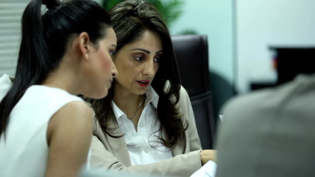 two businesswomen doing meeting in the office, delhi, india - manager stock videos & royalty-free footage