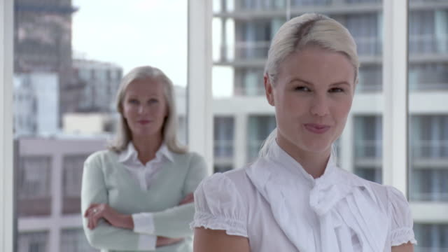 Two businesswomen in office, portrait