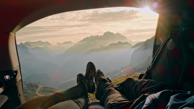 ms two campers resting in the trunk of the car in mountains - tenda video stock e b–roll