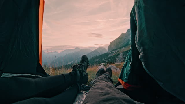ms two campers resting in their tent in mountains - camping stock videos & royalty-free footage