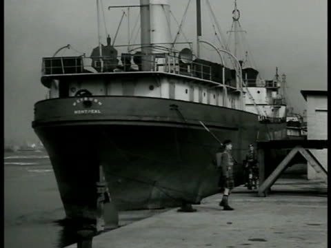 two canadian guards in kilts patrolling montreal dock ship two canadian mounted police talking men unloading bg cu notice by st wood about enemy... - 1939 stock videos & royalty-free footage