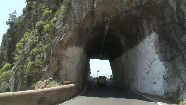 MS Two car moving under tunnel in rock at Amalfi coast / Amalfi, Campania, Italy