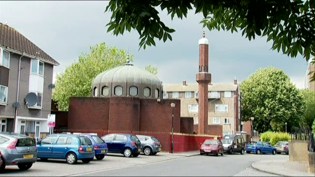 two cardiff students fighting with isis group in iraq crescent moon symbol on top of mosque mosque railings pull focus sign 'islamic centre' imam... - isis stock videos and b-roll footage