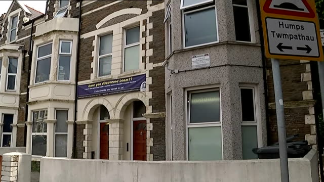 two cardiff students fighting with isis group in iraq wales cardiff gv islamic centre banner over entrance - isis stock videos and b-roll footage