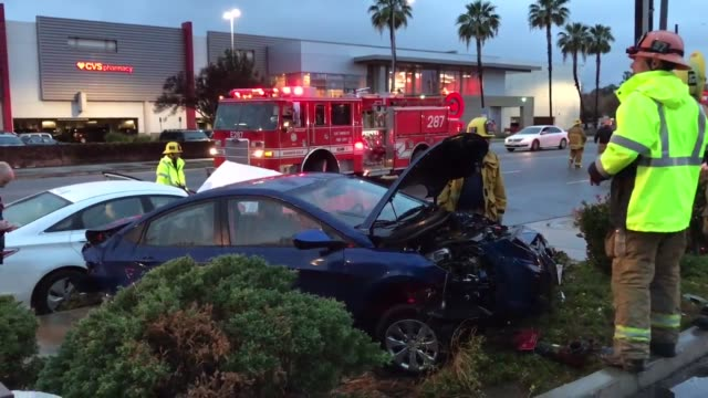 two cars collide causing one to crash into a hydrant in northridge. - northridge stock videos & royalty-free footage