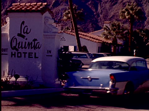 1965 WS PAN Two cars pulling into parking lot of La Quinta Hotel/ California