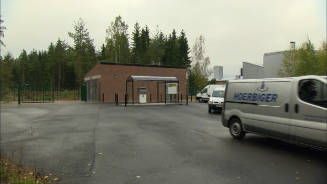 ws two cars pulling out of biogas filling station / vaxjo, sweden - vaxjo stock videos & royalty-free footage