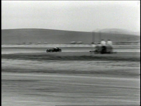WS Two cars racing around a dirt track / United States