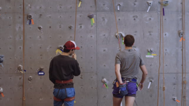 two caucasian men at a climbing wall - climbing wall stock videos & royalty-free footage