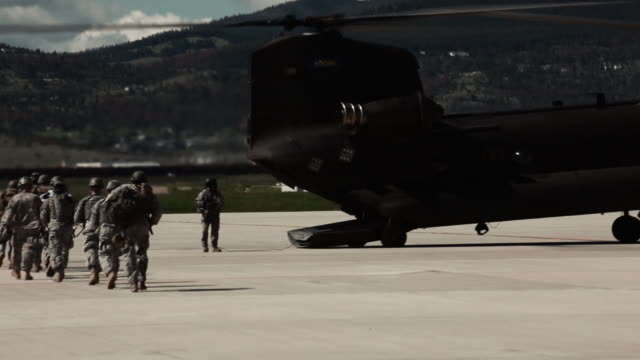stockvideo's en b-roll-footage met two ch-47 chinook helicopters at an airfield. - amerikaans strijdkrachten