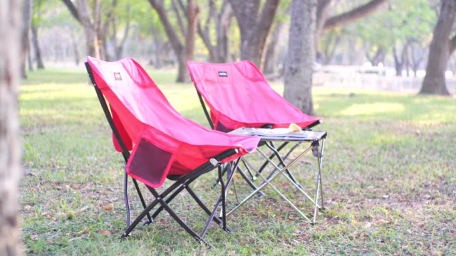 two chairs for camping in the park - outdoor chair stock videos & royalty-free footage