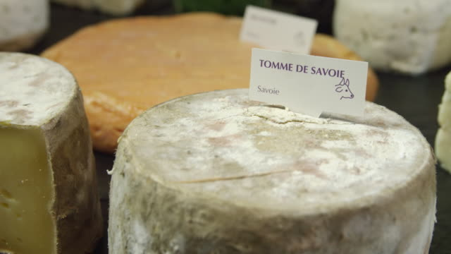 ecu r/f two cheeses 'tomme de savoie' and munster - cheese stock videos & royalty-free footage