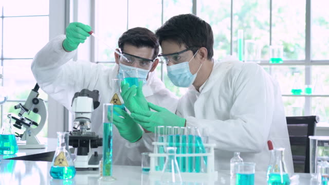 two chemists working on chemical substances in a laboratory - folding stock videos & royalty-free footage