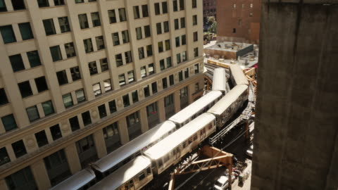 two chicago l train passing on elevated track. view from above - chicago 'l' stock videos & royalty-free footage