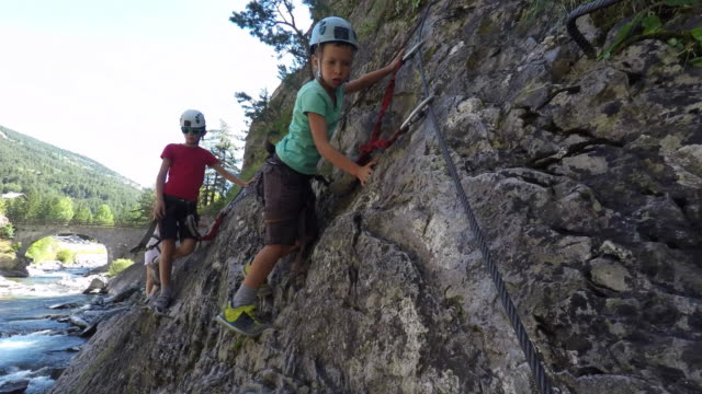 two children and woman on via ferrata, climbing - drei personen stock-videos und b-roll-filmmaterial