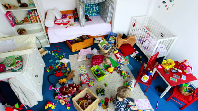 ms t/l two children cleaning up messy nursery / munich, bavaria, germany - 無秩序点の映像素材/bロール