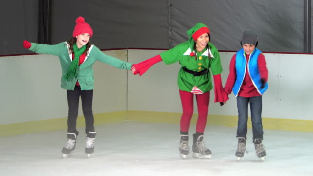 two children ice skating with santa's elf - 10 11 years stock videos & royalty-free footage