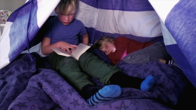 two children playing in a tent - playhouse stock videos and b-roll footage