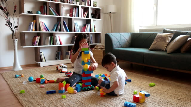two children playing with toy blocks. - art and craft stock videos and b-roll footage