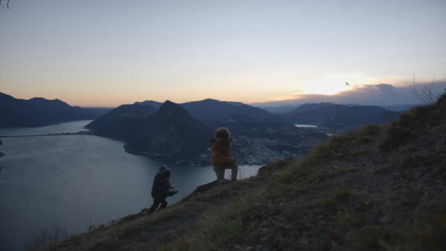 two children running up mountain trail at sunset - fairytale stock videos & royalty-free footage