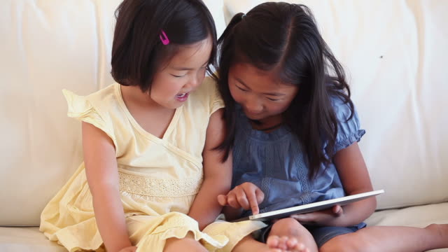Two children using a tablet computer together