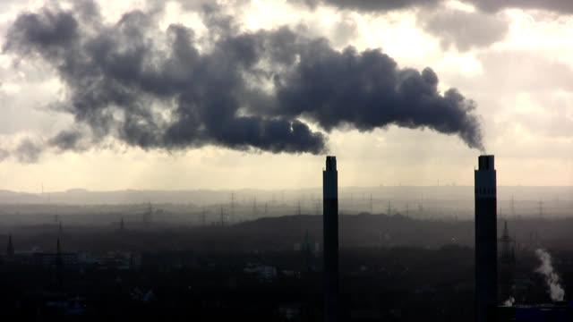 stockvideo's en b-roll-footage met two chimneys with smoke - schoorsteen