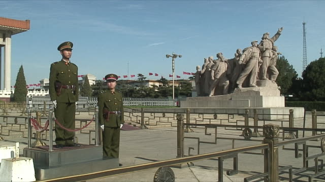 two chinese officials watching tiananmen square - piazza tiananmen video stock e b–roll
