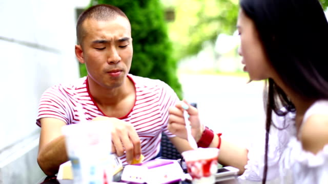 Two Chinese people having lunch.